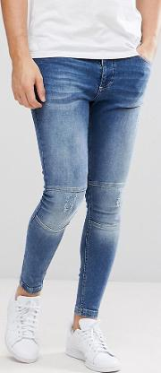 muscle fit biker jeans in midwash blue with zip ankles