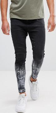 muscle fit drop crotch jeans in black with paint splat