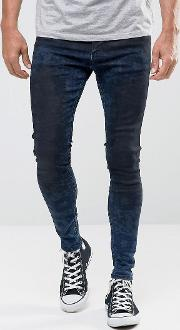 muscle fit jeans in midwash blue with black fade