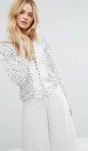 lace up front blouse in dot print