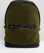 backpack in khaki borg with faux leather trims