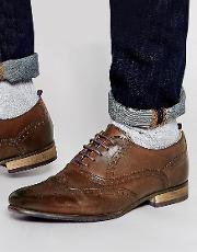 brogue shoes in brown leather with coloured tread