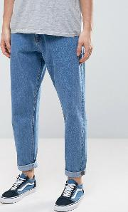 asos oversized tapered jeans in vintage mid wash blue
