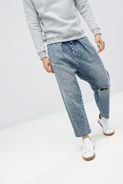 design barrel jeans in mid wash blue with rips
