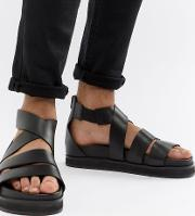 gladiator sandals in black leather with chunky sole