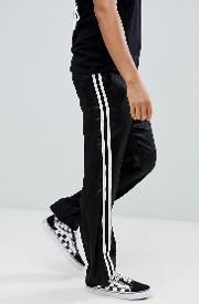 design skater trousers in black satin with side tape