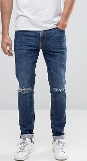 Skinny Jeans With Knee Rips Dark Wash