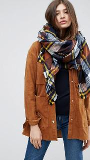 oversized square scarf in brown based check with yellow highlight