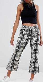 asos design petite crop kick flare jeans in mono check print