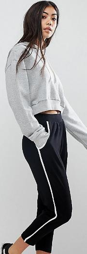 asos design petite tapered trousers with contrast bind