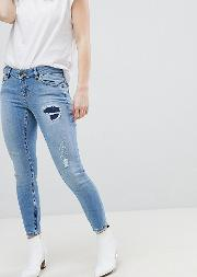 asos design petite whitby low rise skinny jeans  mid wash blue with rip and repair