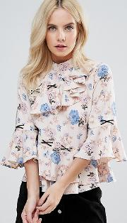 asymmetric ruffle blouse in floral print with contrast lace up