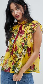 yellow floral sleeveless blouse with ruffle front