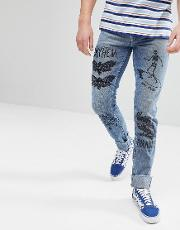 slim jeans in mid wash blue with prints