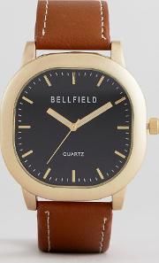 watch with brown strap and gold case