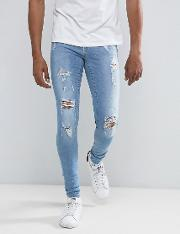 flurry muscle jean with rips light wash