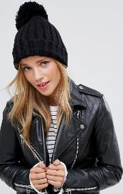 black ribbed hat with knitted pom