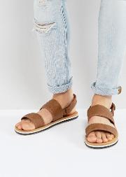 howland sandals in tan