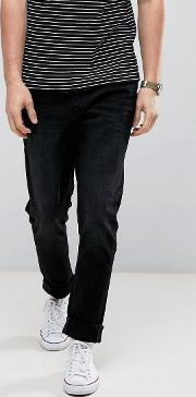 slim fit jeans in black with distressing