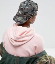 baseball cap in camo with embroidered logo