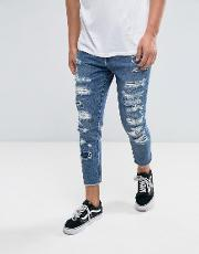 Skinny Jeans With Distressing And Raw Hem