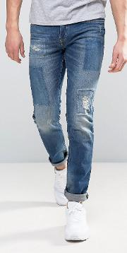 Jeans In Slim Fit With Repair Patch Details