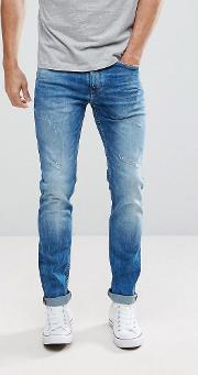 Slim Fit Jeans In Mid Wash Blue With Distressing