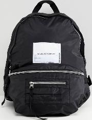 multi pocket backpack with patch