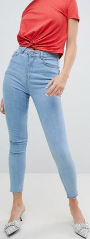 raw hem high rise skinny jeans with rose embroidered pocket