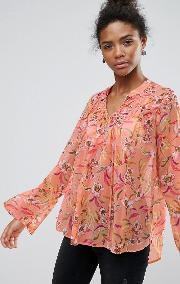 floral print bell sleeve blouse with front smocking detail