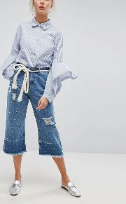 wide leg cropped jean with unravelled hems and pearl embellishment