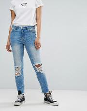 mom jeans with distressing and paint splash