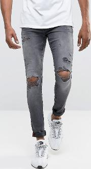jeans super skinny spray on  with busted ripped knees  grey