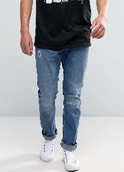 ed 55 tapered jeans with distressing