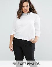plus high neck blouse with embellishment