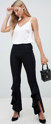 tailored trouser with ruffle flare hem in black