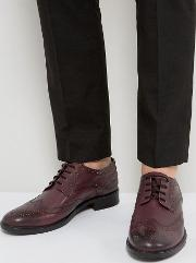brogues in burgundy leather