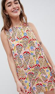 sleeveless shift dress with tie back in paisley print