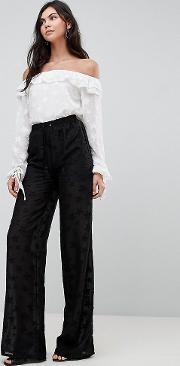 wide leg trousers with sheer star embroidery