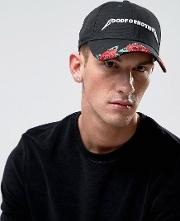 baseball cap in black with embroidered roses