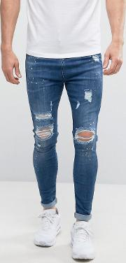 muscle fit jeans in dark blue with distressing
