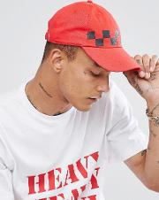 baseball cap in red with checkerboard print