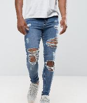 Skinny Jeans  Mid Blue With Distressing