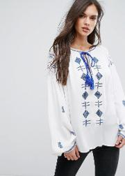 embroidered tassle long sleeve blouse