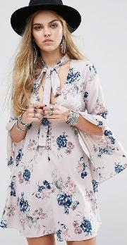 button front tea dress with flared sleeves and tie neck detail in floral