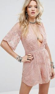 plunge front playsuit in layered lace