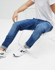 slim fit jeans in mid wash blue