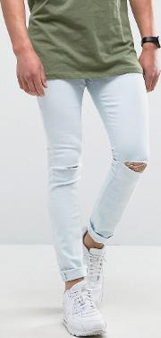 super skinny light wash jeans with knee rip