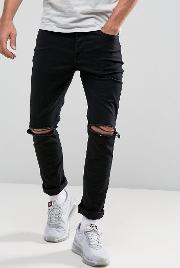 muscle jeans in washed black with knee rips