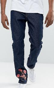 slim jeans in blue with floral embroidery